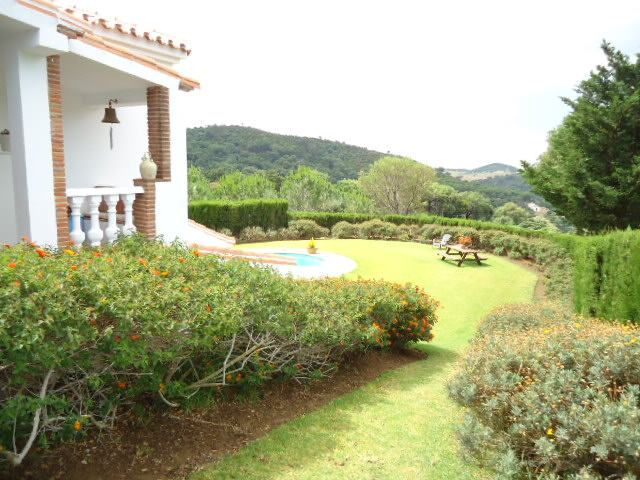 view from covered patio to garden and hills