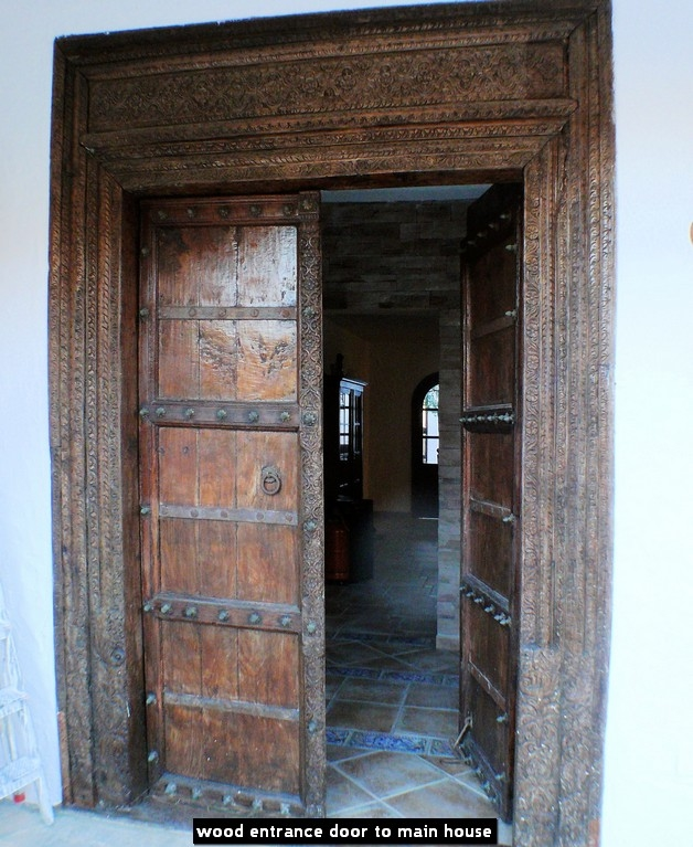 wood entrance door to main house