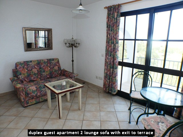 duplex guest apartment 2 lounge sofa with exit to terrace