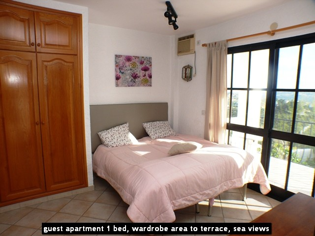 guest apartment 1 bed, wardrobe area to terrace, sea views