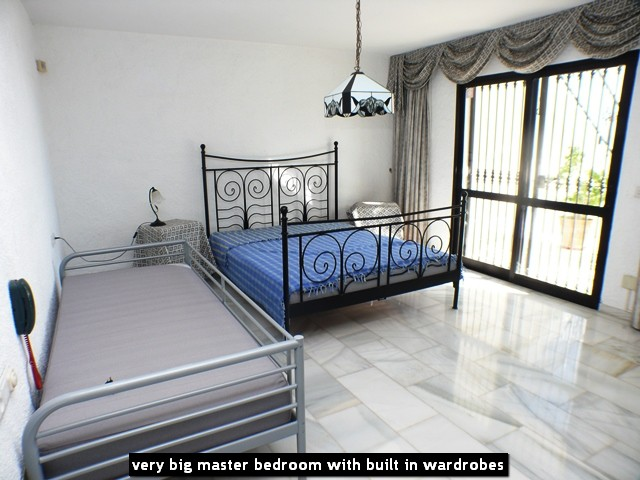very big master bedroom with built in wardrobes