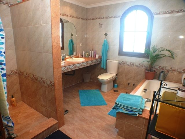 main master bathroom with bath and shower